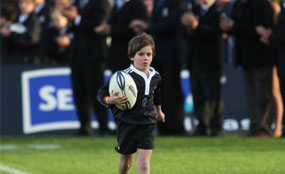 Child on rugby field.